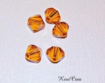 5 x Crystal bicone 6 mm Swarovski orange amber