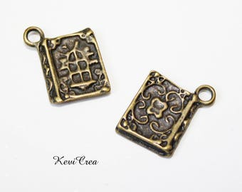 10 x bronze book charms
