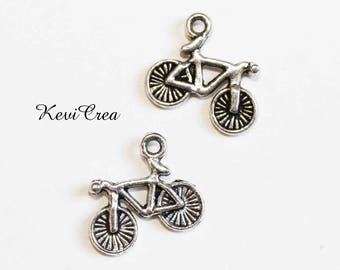8 x silver bicycle charms
