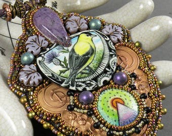 The Thistle Eater | Bead embroidered necklace with goldfinch & thistle hand-painted cabochon accented by pencil on copper cab, purple, green