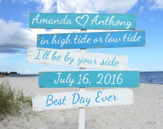 Wedding direction sign. In high tide or low tide wood sign