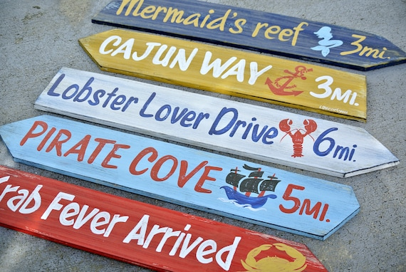 Pool deck decor. Rustic home bar directional signs. Restaurant wall decor.