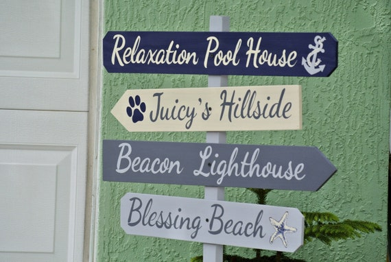 Pool House Decor. Deck wood Direction sign for outdoor garden.