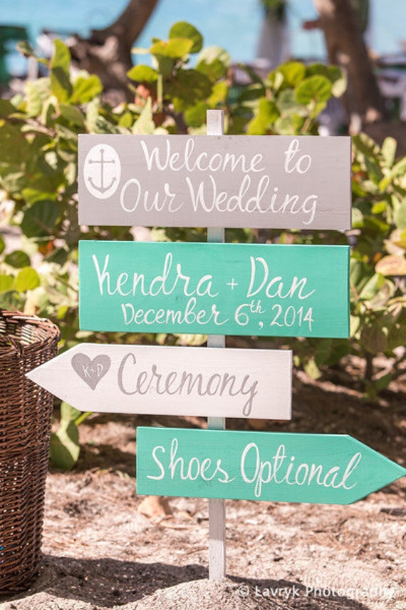 Turquoise wedding decor. Wedding direction sign for ceremony.