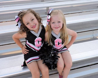 Customizable Girls Cheer uniform! Fun for dress up, halloween or to show team spirit! Built in shorts and bow included!