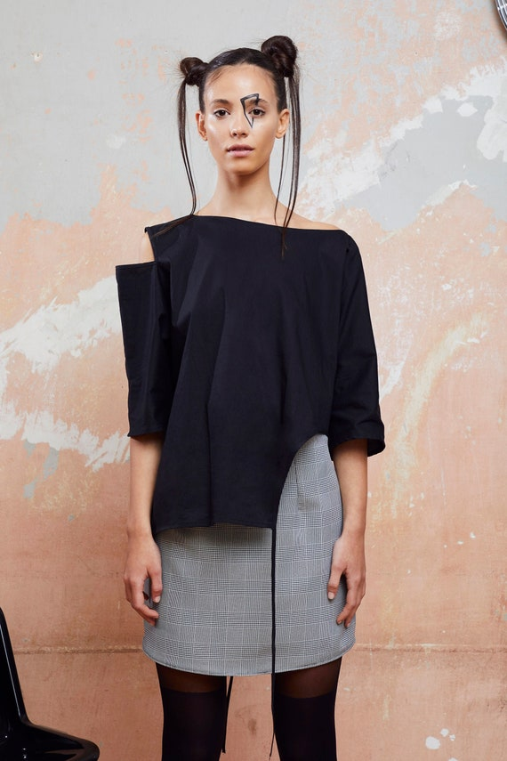 Asymmetrical women's blouse with shoulder cut available in black & white color, one size women's blouse
