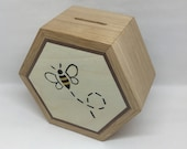 A Beautifully Hand Made Solid Oak Hexagonal Money Box Hand Decorated with a Flying Honey Bee Marquetry Design