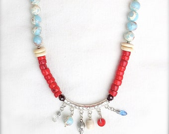 Sterling, red coral, shou shan blue snakeskin stone Jasper, faceted Amethyst,  all joined together to create a statement designed necklace