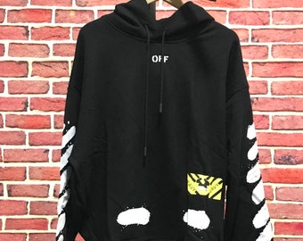 b47b44342747 Off-white style Diagonal Spray Hoodie in Black and White