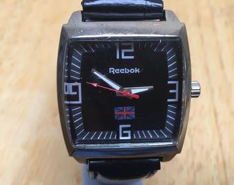 3354d1e9eee7 Vintage Reebok Mens Silver Barrel Black Dial Analog Watch Hours~New Battery