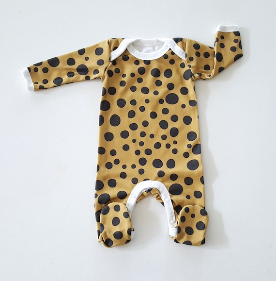 d8c0b2a0e8df Organic baby footie in leopard dots on mustard baby coming