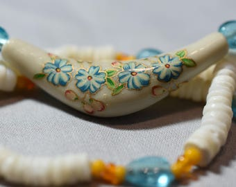 Painted flower pendant with shells and blue beads