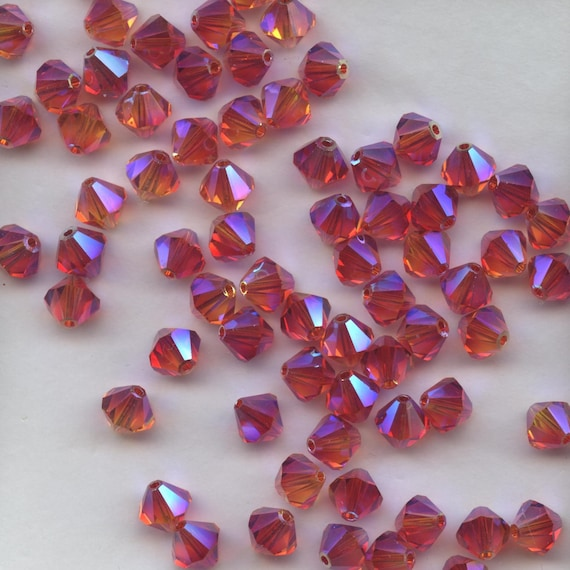 7 Perles Toupies 4mm cristal Swarovski LIGHT SIAM