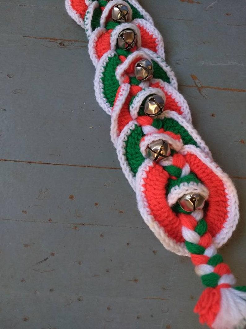 Vintage yarn and jingle bell door hanger