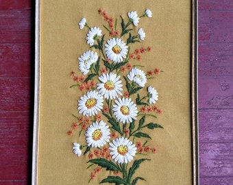 Vintage framed crewel embroidery stitchery of daisies and other flowers, 1970s, mustard yellow