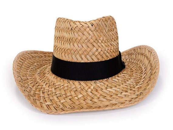 Cowboy hat decorated with with a black ribbon   a gold  98e60213e523