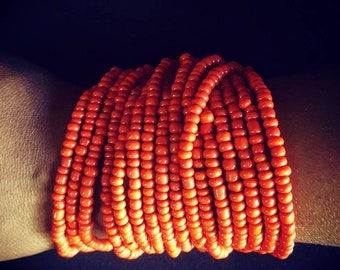 Coral Beaded multi layered bracelet adorned with wooden clasps