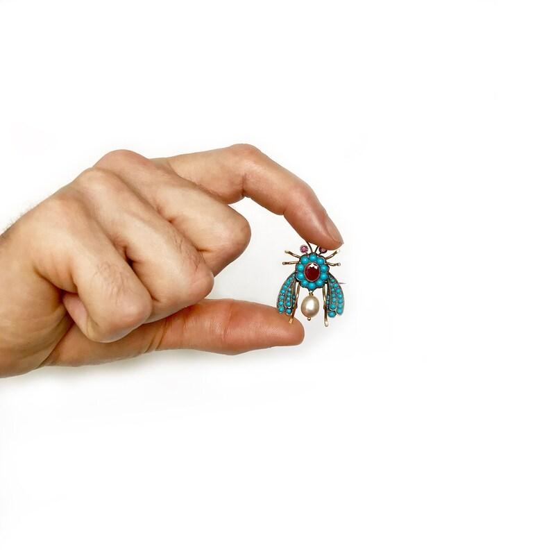 Two fists touching stickpin
