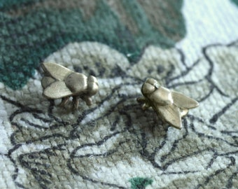 Hand-made insect-shaped pearl earrings.