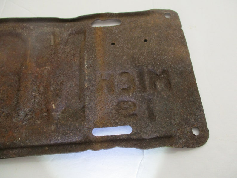 License  plate is from 1911 Early Brass Age car license plate 10/% off was 200. is for Michigan and is # M89