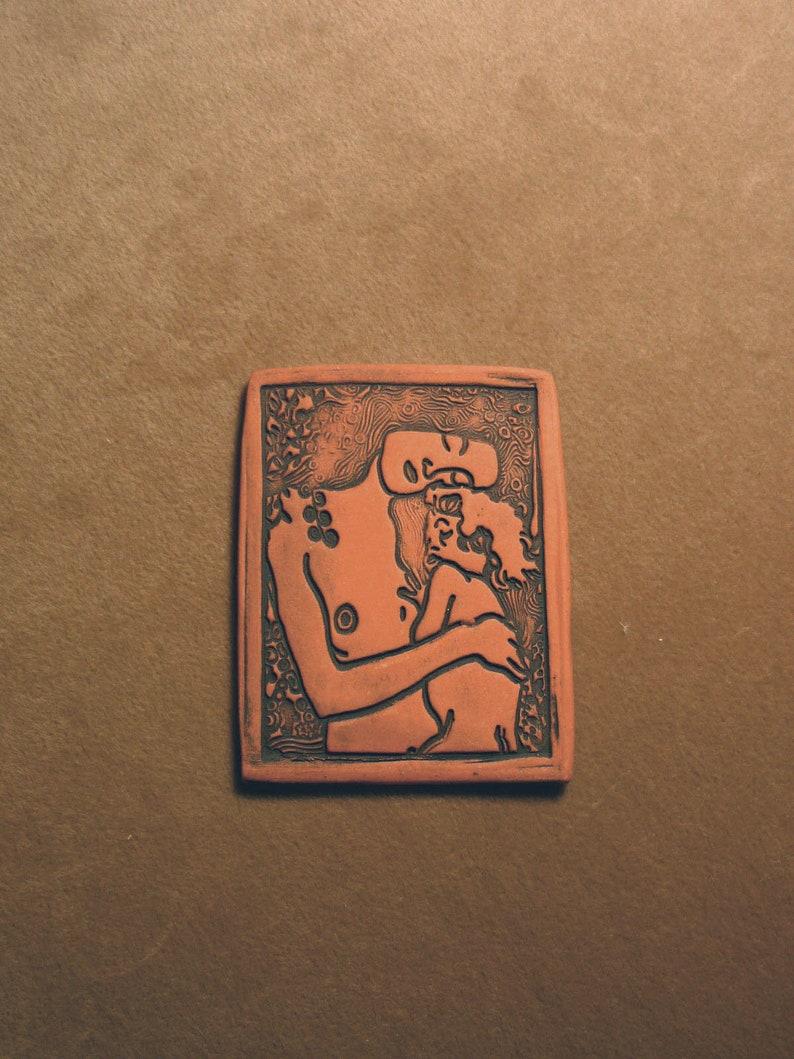 Handmade ceramic flat bead mother child love protection beading jewelry altar purse doll magic strength guardian the face Diane Briegleb 421