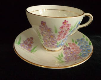 CLARE Bone China Teacup and Saucer Made In England with Pink Purple and Blue Flowers and Gold Gilding