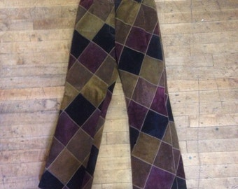 """womens 1970s suede leather patchwork flates by Cordoba London. 26-27"""" waist, size small."""