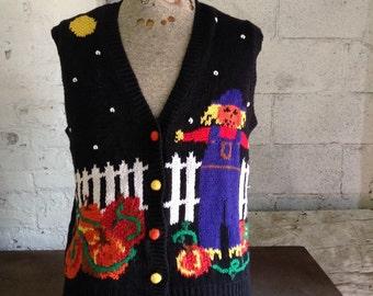 Cute Halloween Sweater vest with scarecrow & pumpkins scene. Size womens Lrg