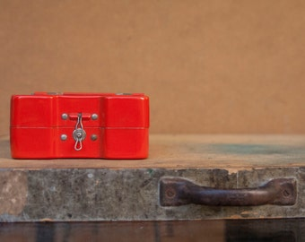 Vintage red metal filing cabinet