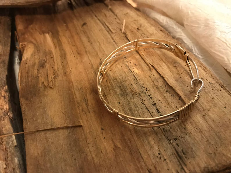 Model K 14k gold and sterling silver bangle bracelet with sterling silver twisted inside and gold accents