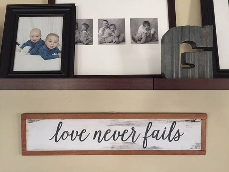Love Never Fails wood sign 20x7 image 0