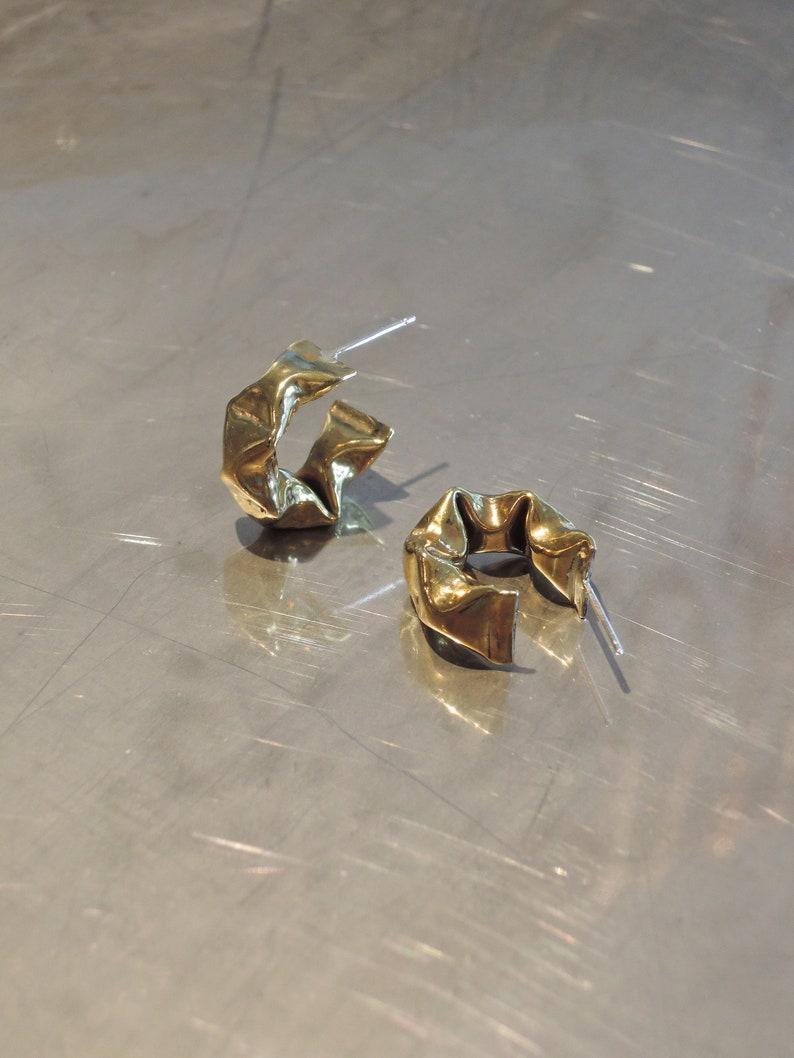 Puffy golden brass semi hoop earrings with silver post
