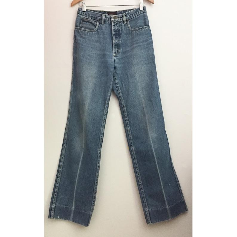 c5998880e56 80s YVES SAINT LAURENT Jeans YsL designer Logo denim 29   Etsy