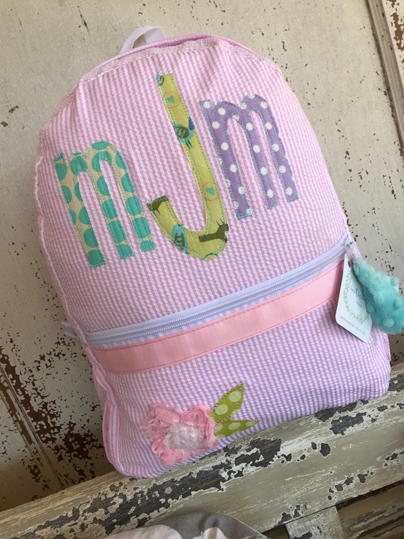 97794be54cf3 Pink Seersucker Backpack with Small Flower design with side