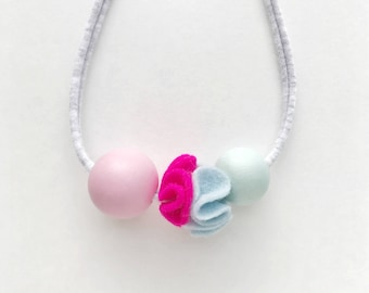 THE WILLOW girls' or women's wood bead and felt pom pom necklace