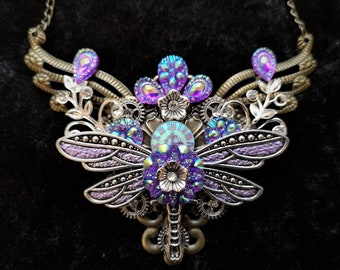 Stunning iridescent Steampunk Fantasy Dragonfly Necklace in purple pink and blue tones with clockface, flowers diamante rhinestone crystals