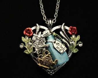 Hand-painted Alice in Wonderland-inspired heart-shaped pendant necklace with White Rabbit, Drink Me bottle, and teapot tea party charms