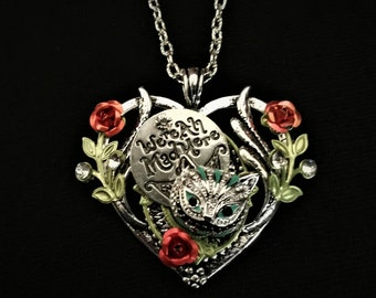 Hand-painted Alice in Wonderland-inspired heart-shaped pendant necklace with the Cheshire Cat, and We're All Mad Here charms