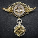 Steampunk Explorer Medal - Winged travel lover's medal pin badge brooch featuring silver compass, pocket watch style case + binoculars charm