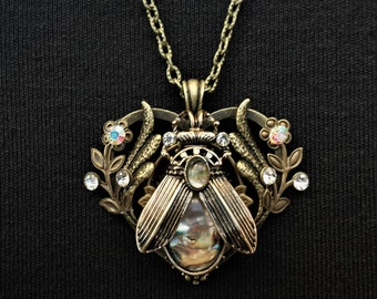 Gothic art nouveau bronze winged beetle pendant with pearlescent abalone effect insets, bronze flowers and diamante rhinestone crystals
