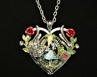 Hand-painted Alice in Wonderland-inspired heart-shaped pendant necklace with Alice, White Rabbit, and Ace of Hearts playing card charms
