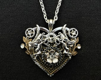 Romantic Steampunk heart-shaped pendant necklace with silver Cupid Eros charms, bronze heart and flowers, and diamante crystal rhinestones