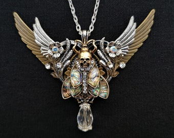 Gothic Art nouveau Death's Head Hawkmoth winged silver heart necklace with pearlescent abalone-style inlays, crystal drop, & rhinestones