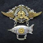 Stunning Steampunk Fantasy winged airship zeppelin pilot aviator medal pin badge brooch with silver compass charm & moving golden propeller