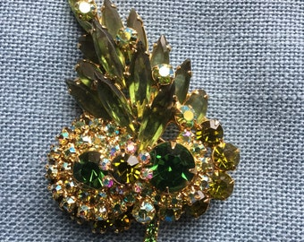 Green Green Green and more Green! Lovely Leaf Pin with different Green Sparkly Stones!  Makes a statement!