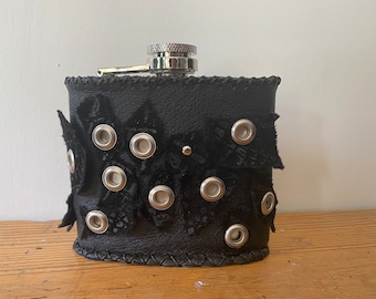 Mixed Leather decorated metal flask with decorative Eyelets.