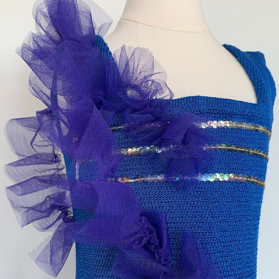 Girl's size 5-6:  Royal blue leotard with purple t