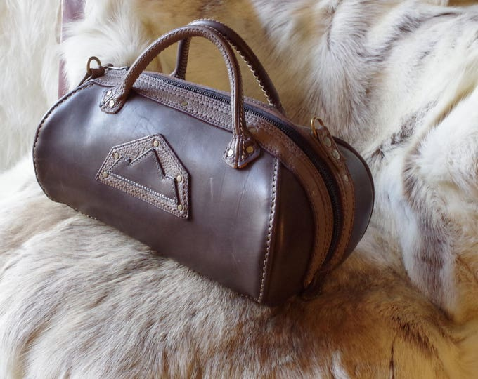taupe and brown leather bowling bag