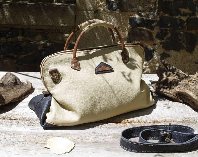 Large handbag, beige and black leather travel bag