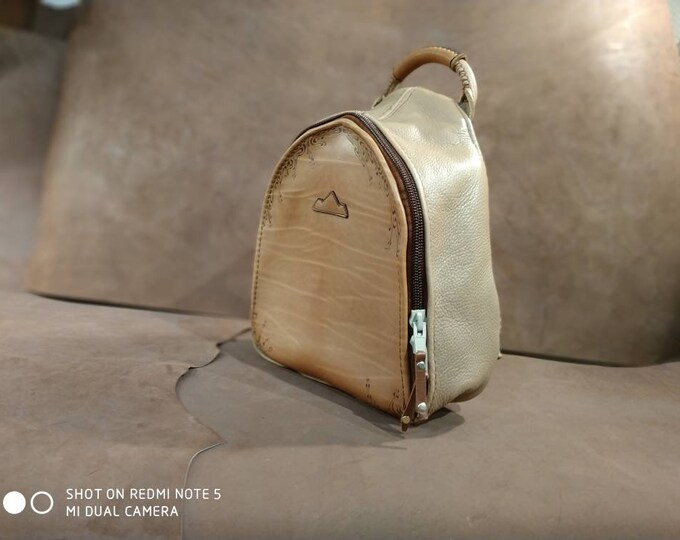 Tan beige brown leather backpack